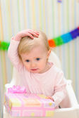 Portrait of embarrassed baby celebrating first birthday — Stock Photo