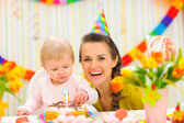Portrait of mother and baby with birthday cake — Stock Photo