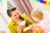 Mother having a tea on first birthday celebration of her baby — Stock Photo