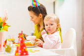 First birthday celebration party with mother and baby — Stock Photo