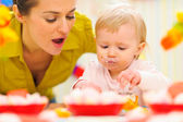 Baby celebrating first birthday with mom — Stock Photo