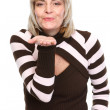 Middle age woman blowing air kiss — Stock Photo