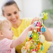 Mother helping baby made Easter decoration - Photo