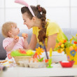 Mother and baby playing with Easter eggs — Stock Photo