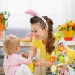 Mother and baby playing with Easter decoration — Stock Photo #9832133