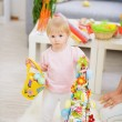Baby holding basket of Easter eggs and decoration — Stock Photo #9832136