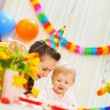 Mother and baby having fun at birthday party — Stock Photo