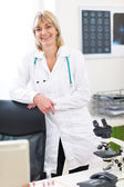 Portrait of smiling senior doctor woman at laboratory — Stock Photo