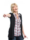 Smiling middle age woman pointing on you — Stock Photo