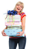 Happy elderly woman with stack of present boxes — Stock Photo