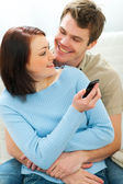 Beautiful girl showing something in cell phone to boyfriend — Stock Photo