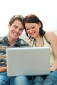 Happy young couple surfing internet — Stock Photo