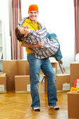 Young couple having fun while moving to new house — Stockfoto