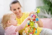 Mother helping baby made Easter decoration — Stock Photo