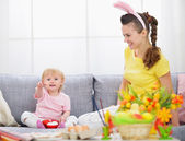 Mother and baby making preparations for Easter — Stock Photo