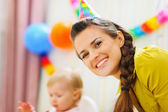 Portrait of happy mother at babies birthday party — Stock Photo