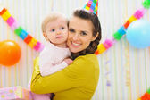 Portrait of happy mother and baby at birthday party — Stock Photo