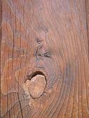 Oude houten plank met één grote knoop — Stockfoto