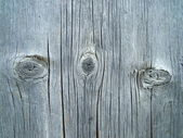 Houten plank textuur met drie knopen — Stockfoto