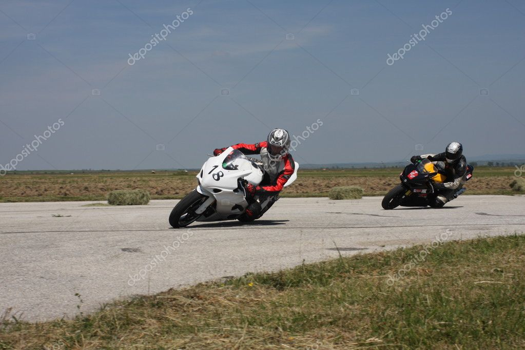 Two motorbike racers entering the left turn on the track. — Stock Photo #9143764