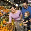 Stock Photo: Family grocery shopping.