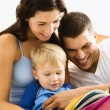 Family reading. - Stock Photo