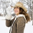 Woman tilting hat. — Stock Photo #9215856