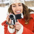 Woman with video camera. - Stock Photo