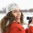 Woman using video camera. - Foto Stock