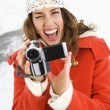 Stock Photo: Womwith video camera.