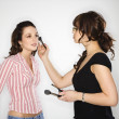 Makeup artist and woman. - Stok fotoğraf