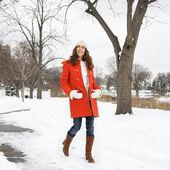 Woman walking in snow. — Stock Photo
