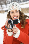 Woman with video camera. — Stock Photo