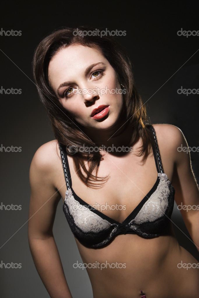 Sexy Caucasian woman in lingerie looking at viewer. — Stock Photo #9217010