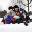 Family sitting in snow. — Stock Photo