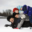 Family stacked in snow. - 