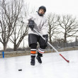 Boy playing ice hockey. — Stock Photo