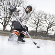 Boy playing ice hockey. - Stock Photo