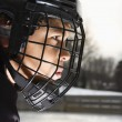 Stock Photo: Ice hockey player boy.