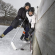Boys playing ice hockey. - Stock Photo