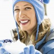 Woman with snowball. — Stock Photo