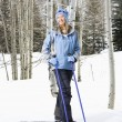 Female skier on slope. — Stock Photo