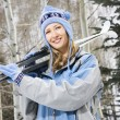 Female holding skis. — Stock Photo #9225584