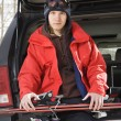 Teenager holding skis. — Stock Photo #9225660