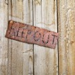 Sign on Old Door — Stock Photo #9225909
