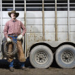 Stock Photo: Man Wearing Cowboy Hat Holding Lariat