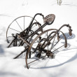 Metal plow in snow - Stock Photo