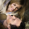 Stock Photo: Couple lying in hay.