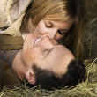 Couple in hay. — Stock Photo