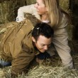 Couple playing in hay. — Stock fotografie